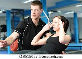 Stomach crunches with personal trainer