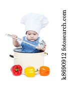 d0e6d8a3d1a Portrait of a smiling baby sitting wearing a chef hat sitting inside a  large cooking stock