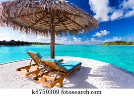 Handmade wicker rocking chair on patio luxury resort hotel caribbean