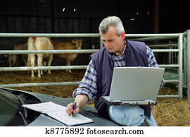 Farmer with a laptop