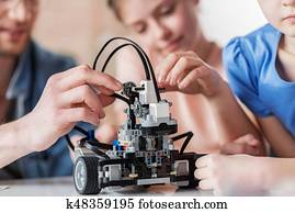 Interested persons working together on robotics