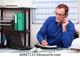 Mechanic on phone in office