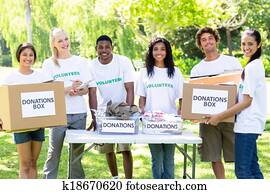 Confident volunteers with donation boxes