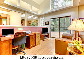 Home office interior with large windows.