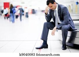 worried businessman lost his luggage