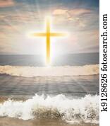 Christian religious symbol cross against sun shine