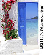 Traditional greek door with a great view on Santorini island, Greece