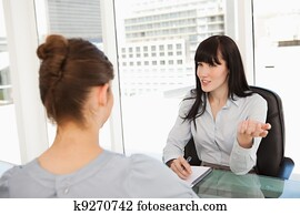 A business woman interviews a potential new employee
