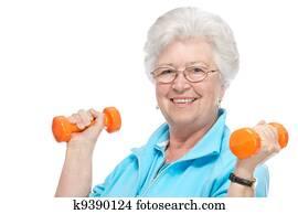 Attractive senior woman at health club