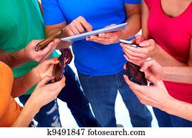 Human hands with tablet and smartphone.