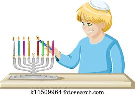 A Boy Lights A Hanukkiah Candle