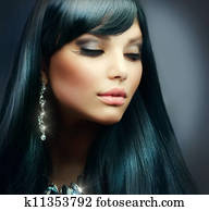 Beautiful Brunette Girl. Healthy Long Hair and Holiday Makeup