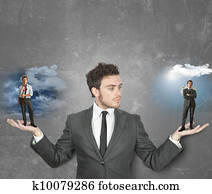 Businessman with devil or angel