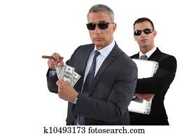 Businessmen with cash