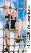 Child climbing on playground