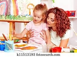 Child painting with mum.