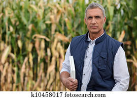 Farmer in a field with a laptop computer