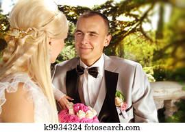 Groom looking on bride