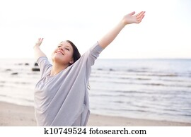 Happy Woman Stretching Her Arms to Enjoy Nature