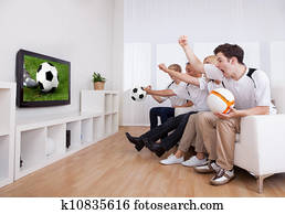Jubilant family watching television
