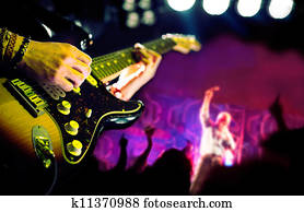 Live music background, Guitar player and public