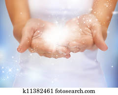 magic twinkles on female hands