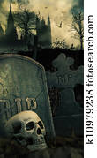 Night scene in graveyard with skull and graves