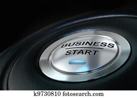 pushed business start button over black background, blue light, symbol of new businesses