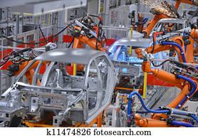 robots welding in factory