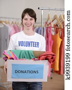 Volunteer with clothes donation box