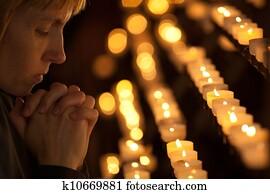 Woman praying in Catholic church