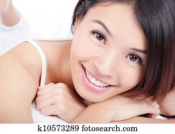 woman smiling face with health teeth