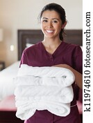 Smiling maid with towels