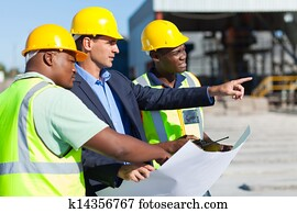 architect and construction workers