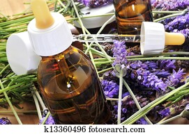 aromatherapy oil and lavender flowers