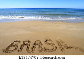 Brasil written on sandy beach