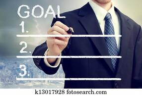 Businessman Listing Goals