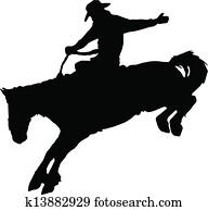 Cowboy riding horse at rodeo.