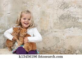 Cute girl holding kittens
