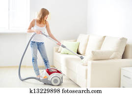 girl cleaning sofa