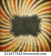 Grunge colorful rays background with vintage label for text.