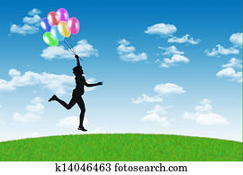 happy woman running with balloons on a blue sky background