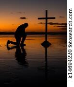 Kneeling Before The Cross