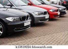 line of luxury used cars