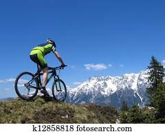 Mountain biker riding through the mountains