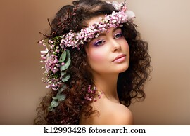 Nymph. Adorable Sensual Brunette with Garland of Flowers looks like Angel