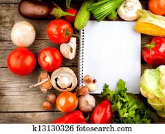 Open Notebook and Fresh Vegetables Background. Diet