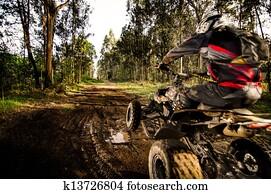 Quad rider jumping