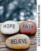 rocks with faith, hope, believe.