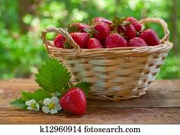 Strawberries in basket on garden table